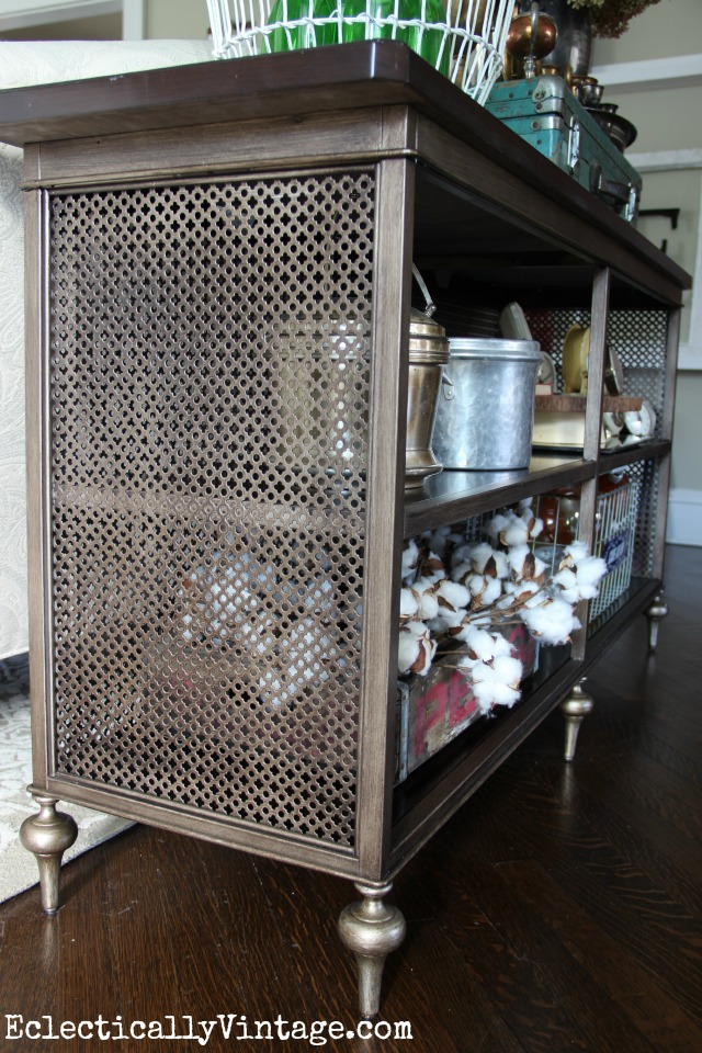 Love the open fretwork of this console table - and all the open shelves for display kellyelko.com