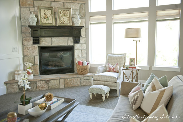 Beautiful stone fireplace in this stunning light and bright family room kellyelko.com