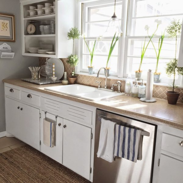 Charming country kitchen - love the open shelves filled with white china kellyelko.com
