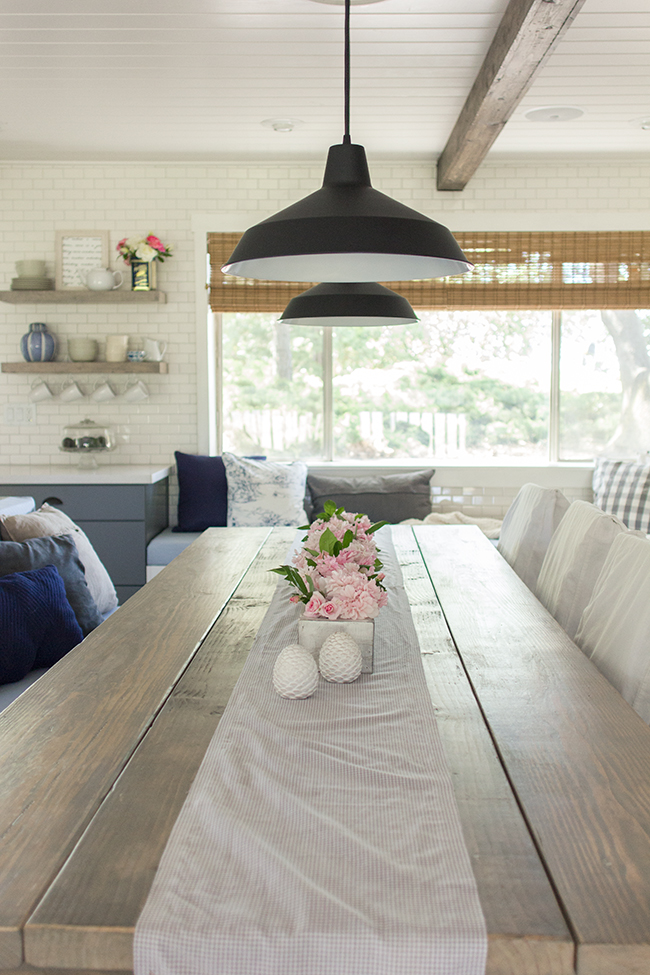 Stunning farmhouse kitchen with subway tile, industrial lighting and a gorgeous table eclecticallyvintage.com