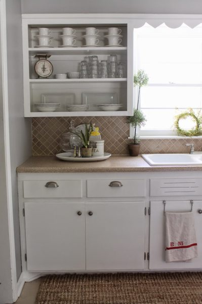 Remove doors from kitchen cabinets and show off collections kellyelko.com