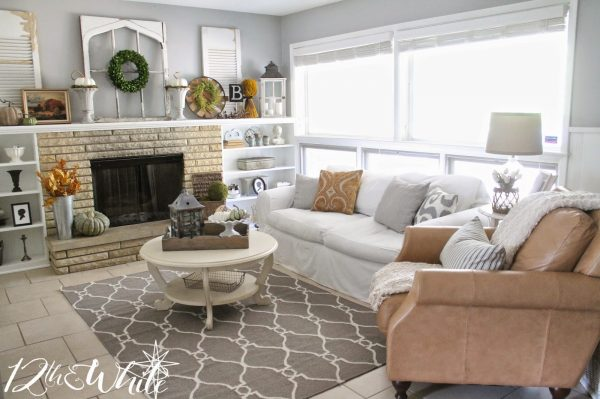 Neutral family room decor - love hte leather club chair kellyelko.com