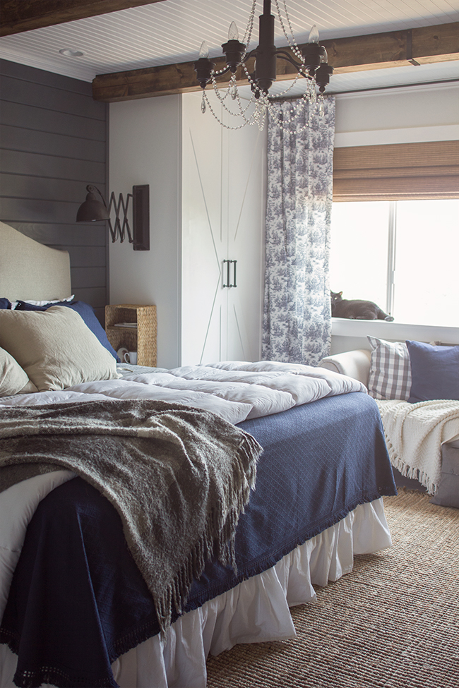 This master bedroom is stunning and all DIY - from the beadboard ceiling to the rustic beams to the built in cabinets with sconces kellyelko.com