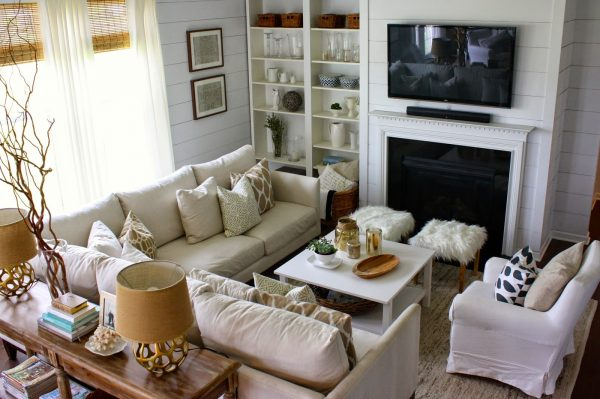 Great furniture layout - love the sectional sofa and the console table with the two little ottomans kellyelko.com