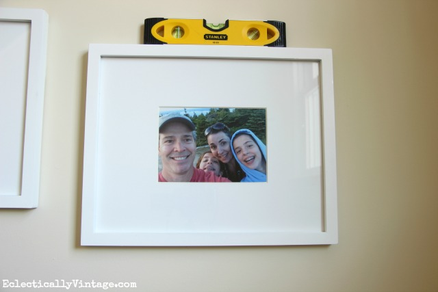Tips on hanging photos and gallery walls kellyelko.com #DamageFreeDIY