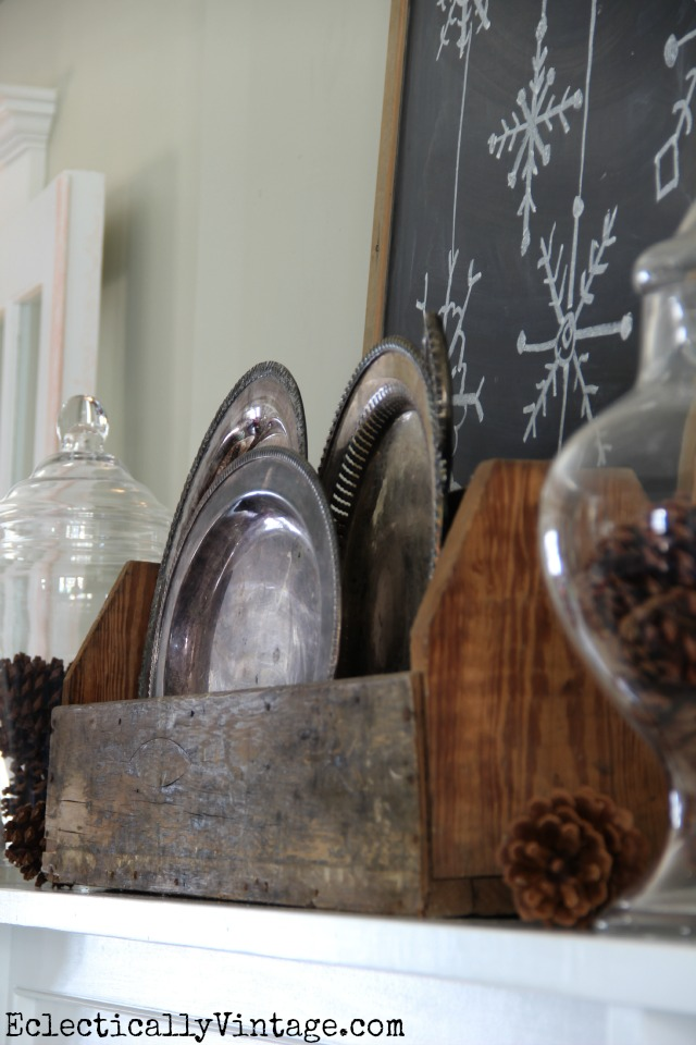 Create a rustic mantel with a few simple elements like tarnished silver and weathered wood kellyelko.com