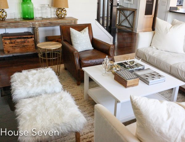 Cozy family room - love the mix of wood, painted coffee table, leather and faux fur kellyelko.com
