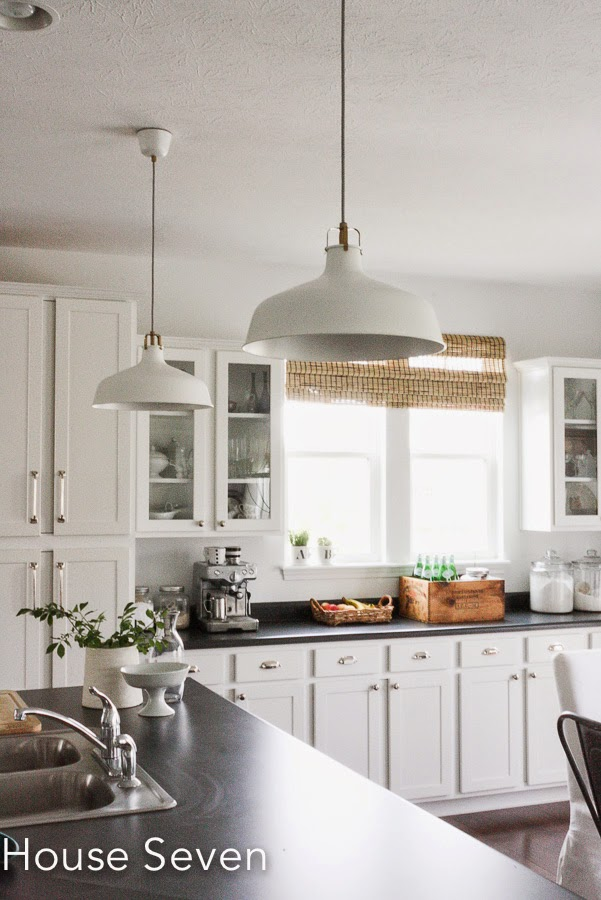 White kitchen with industrial pendant lights kellyelko.com