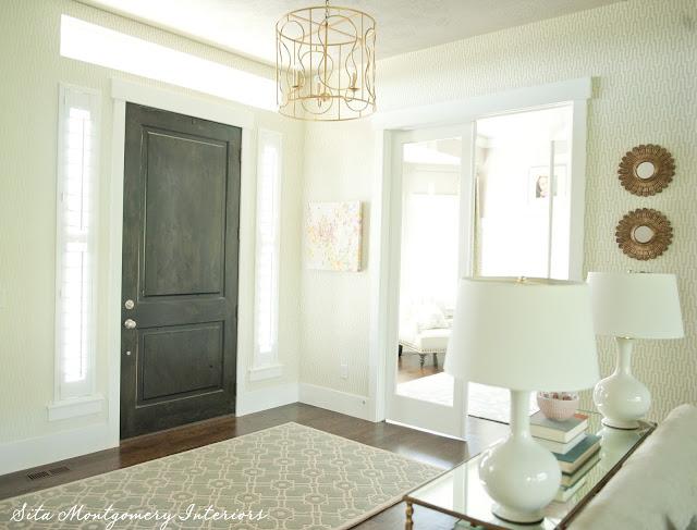 Gorgeous entry foyer - love the dark stained interior door kellyelko.com