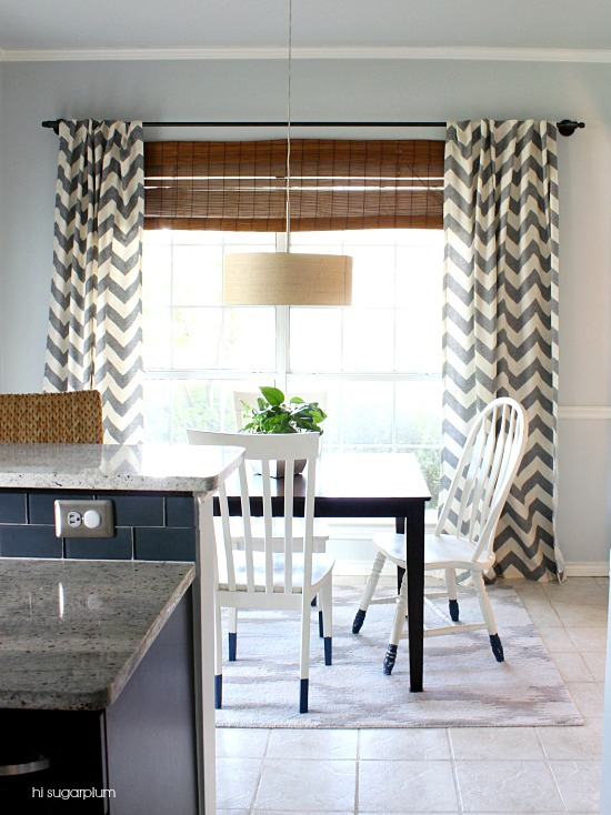 DIY industrial pipe curtain rod with chevron curtains - and I love the dip dyed chair legs kellyelko.com