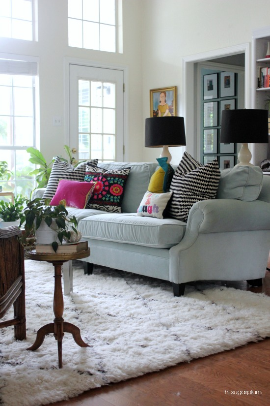 Love this gorgeous living room with pale blue sofa and colorful pillows kellyelko.com