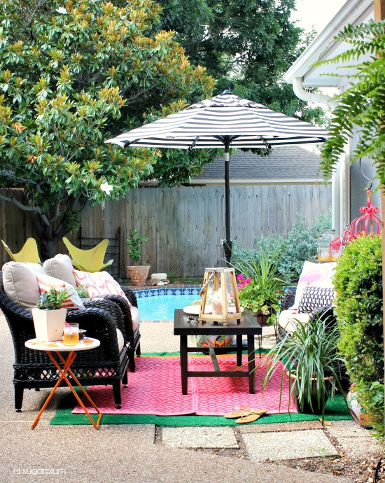Colorful patio by the pool - love the mix of color and pattern kellyelko.com