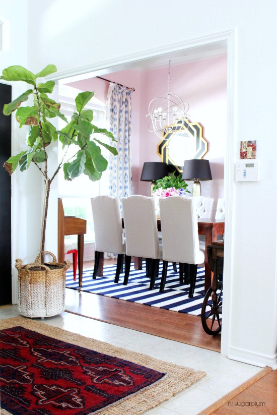 Love this colorful home - and the pink dining room with a red ceiling kellyelko.com