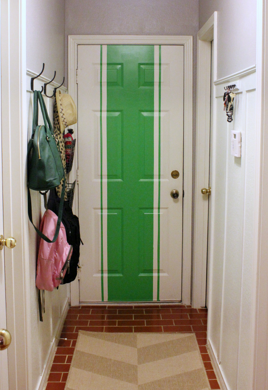 Fun mudroom door with bold green stripe kellyelko.com