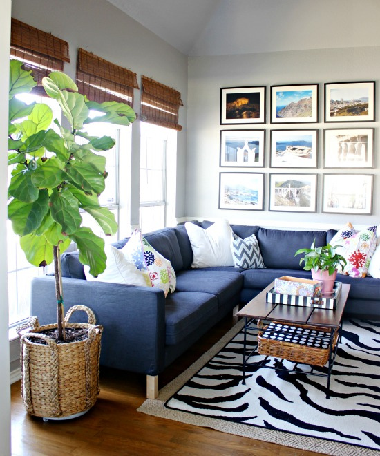 Fun, colorful and eclectic family room - love the blue sectional sofa, vacation photo gallery wall and fiddle leaf fig kellyelko.com