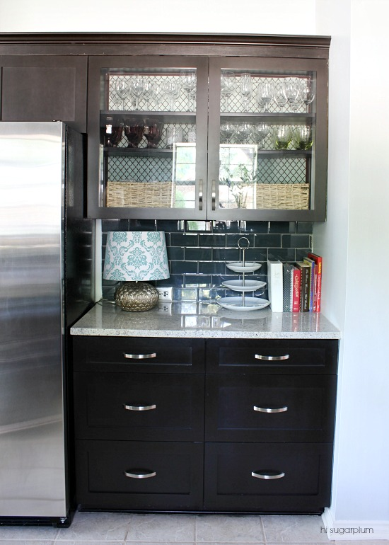 Love the wire mesh cabinets in this kitchen kellyelko.com
