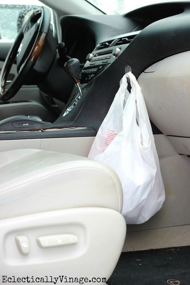 Great idea - hang a trash bag from a hook in the car! kellyelko.com #DamageFreeDIY