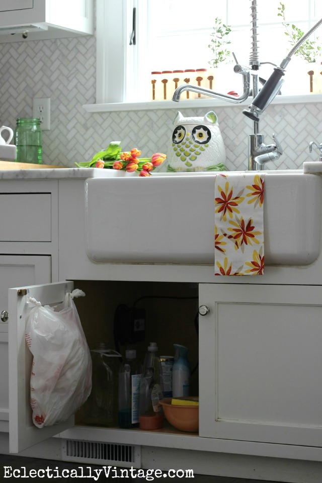 Five favorite command hook organization ideas - love this idea for under the sink plastic bag storage kellyelko.com #DamageFreeDIY