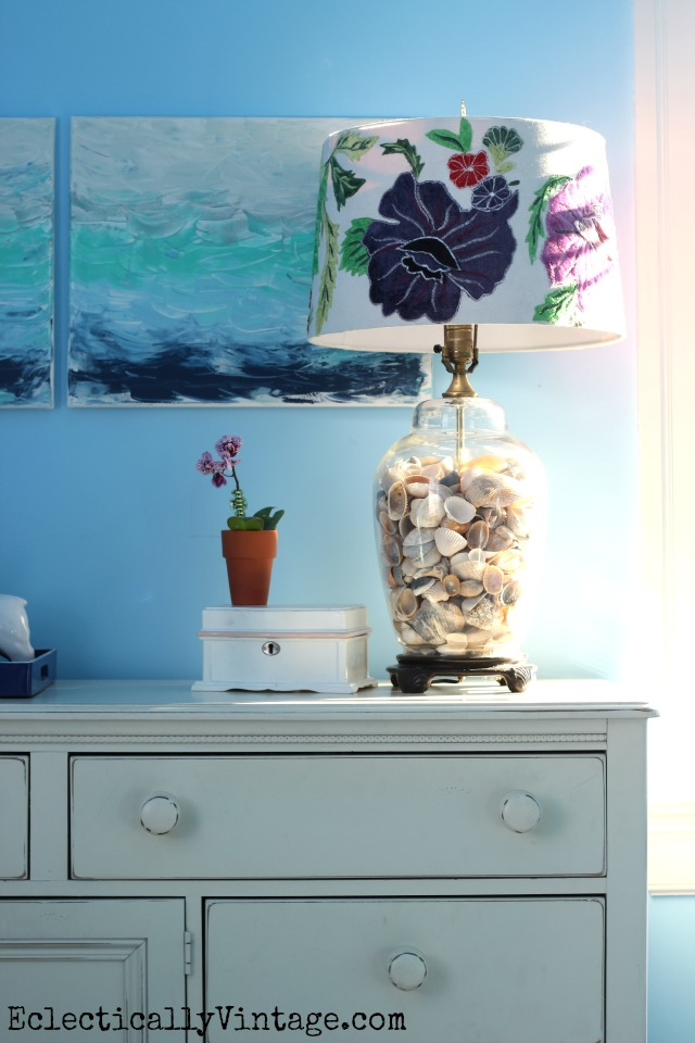 Love this glass lamp filled with shells and the gorgeous floral embroidered lampshade! kellyelko.com