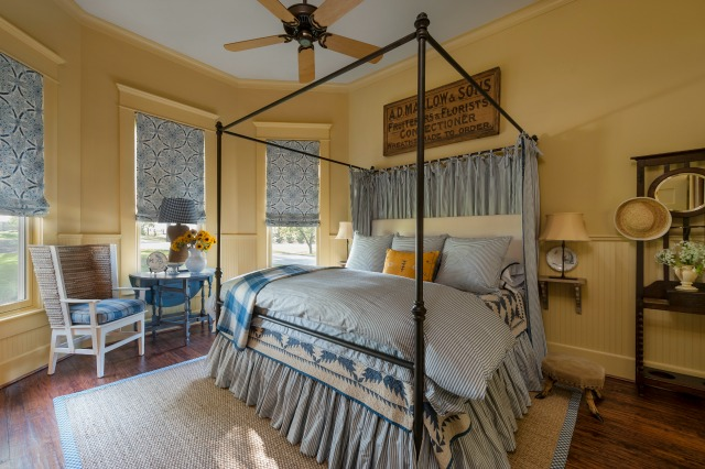 Cozy yellow and blue bedroom - love the four poster bed and the brackets instead of nightstands kellyelko.com