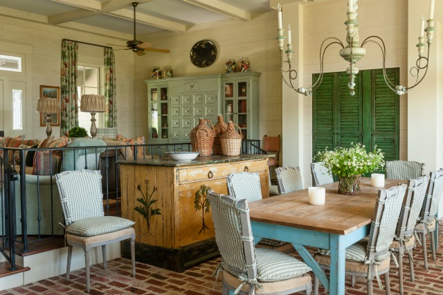Charming home filled with antiques that make it warm and inviting - love the farmhouse table and brick floor kellyelko.com