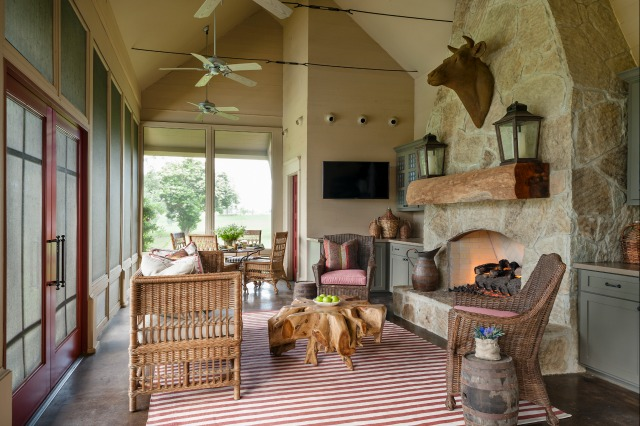 Love this cozy room with the stone fireplace and that huge wood slab as a mantel kellyelko.com