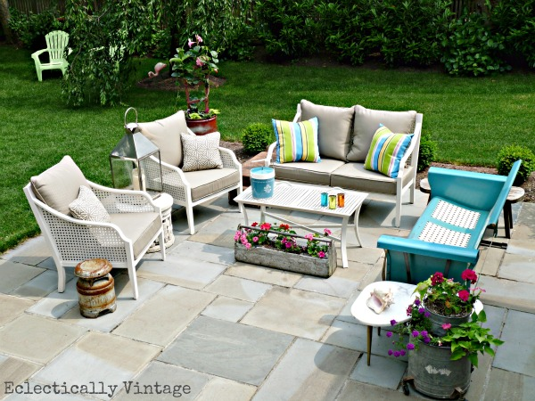 Love this blue stone patio and the eclectic mix of furniture kellyelko.com