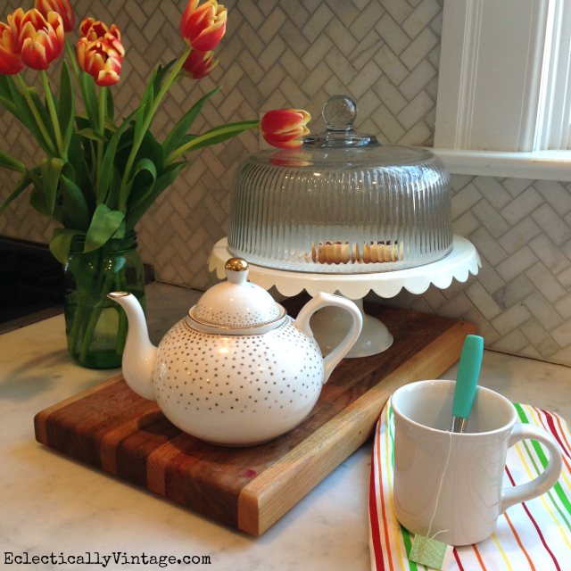 Tulips brighten up any space - love the gold teapot kellyelko.com