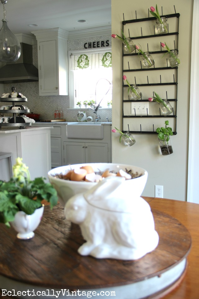 Love this kitchen and the huge bottle drying rack is so fun as a flower display plus see more creative display ideas and where to buy it! kellyelko.com