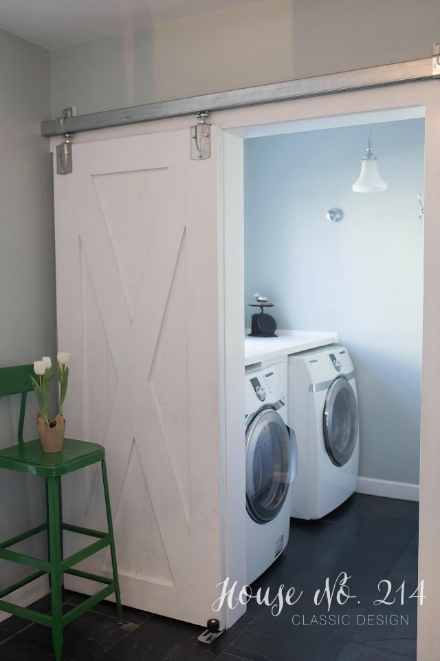 DIY Rolling Barn Door in the laundry room kellyelko.com