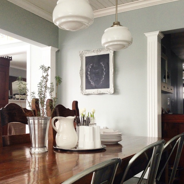 Farmhouse dining room - love the mismatched chairs and school house lights kellyelko.com