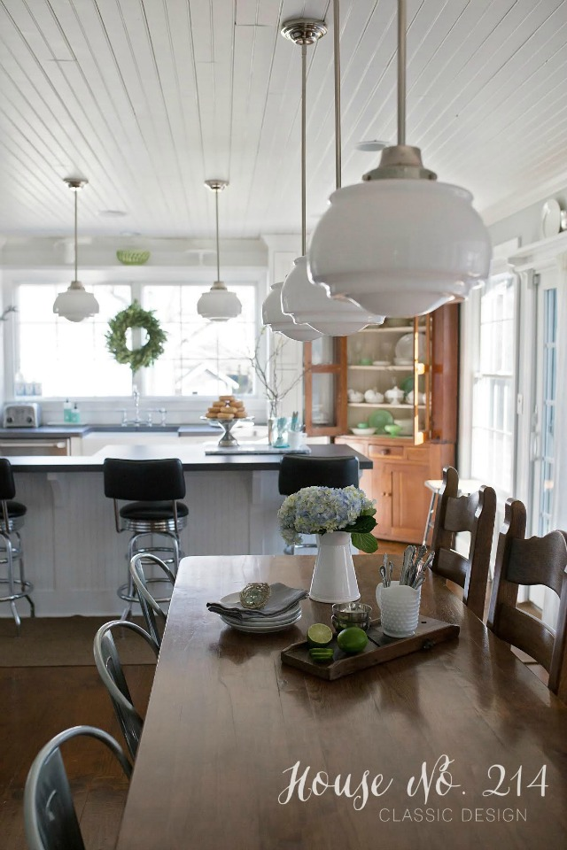 Love this farmhouse kitchen - look at those schoolhouse lights! kellyelko.com