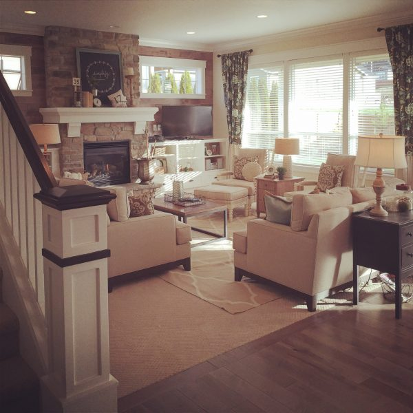Beautiful family room with stone fireplace and neutral shades kellyelko.com