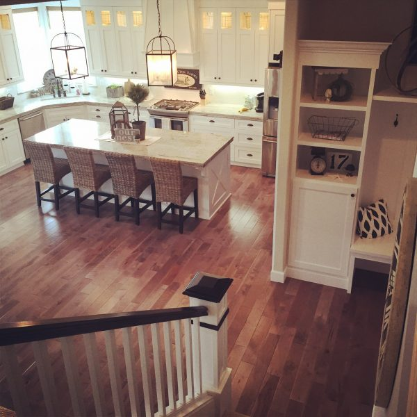 Love the flow of this house with the open white kitchen and large island kellyelko.com
