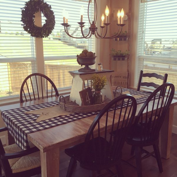 Breakfast nook with lots of light - love the mismatched chairs and chandelier kellyelko.com