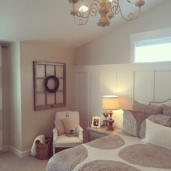 Architectural elements like a vintage window can add so much character to a master bedroom kellyelko.com