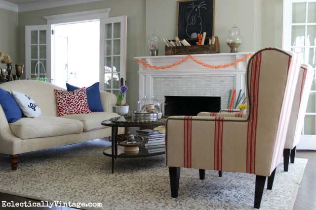 Love this light and bright living room and those red grain sack chairs! kellyelko.com