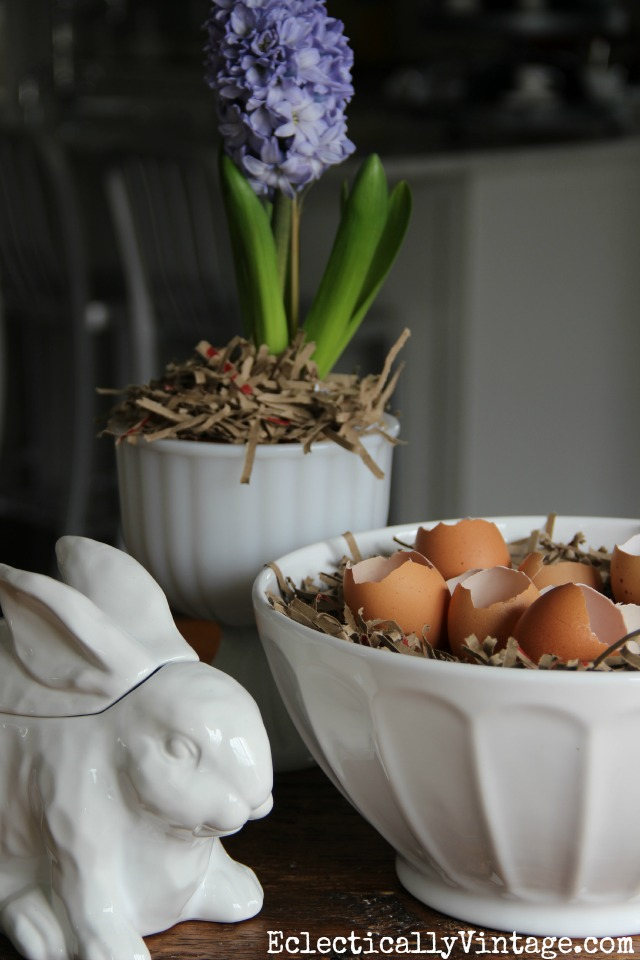 Simple spring decorating idea using natural elements - love the bowl filled with cracked eggs kellyelko.com