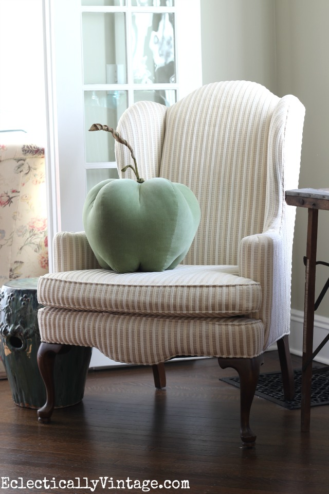Love the neutral wing back chair with the fun apple pillow! kellyelko.com