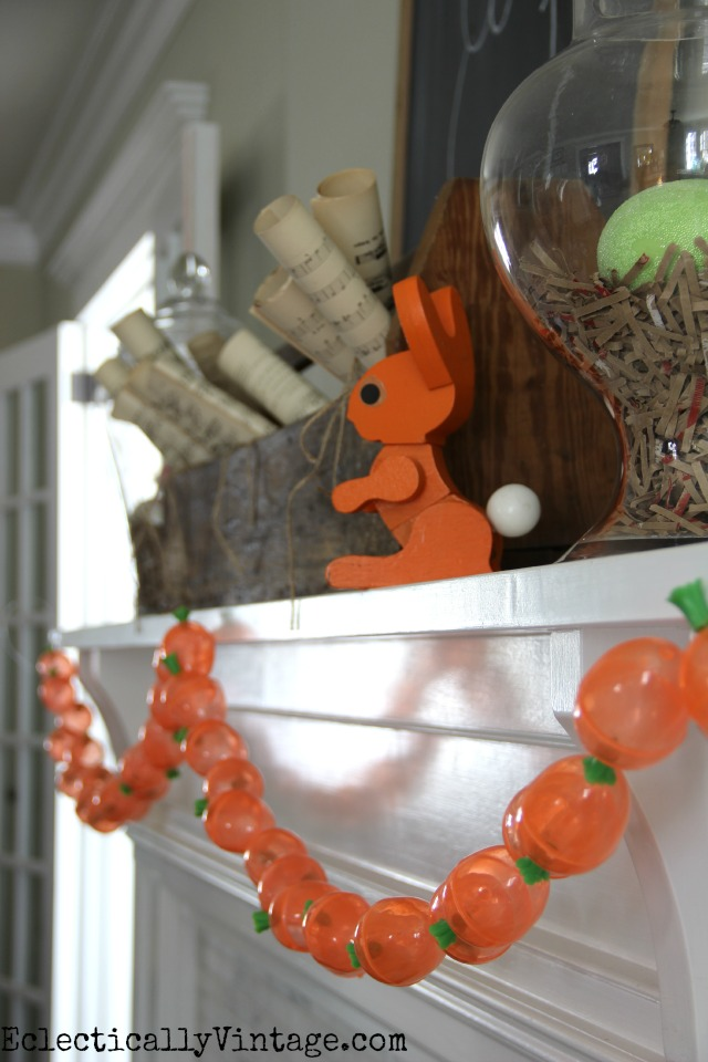 How ridiculously cute is this spring mantel and carrot garland?  See how to make your own kellyelko.com