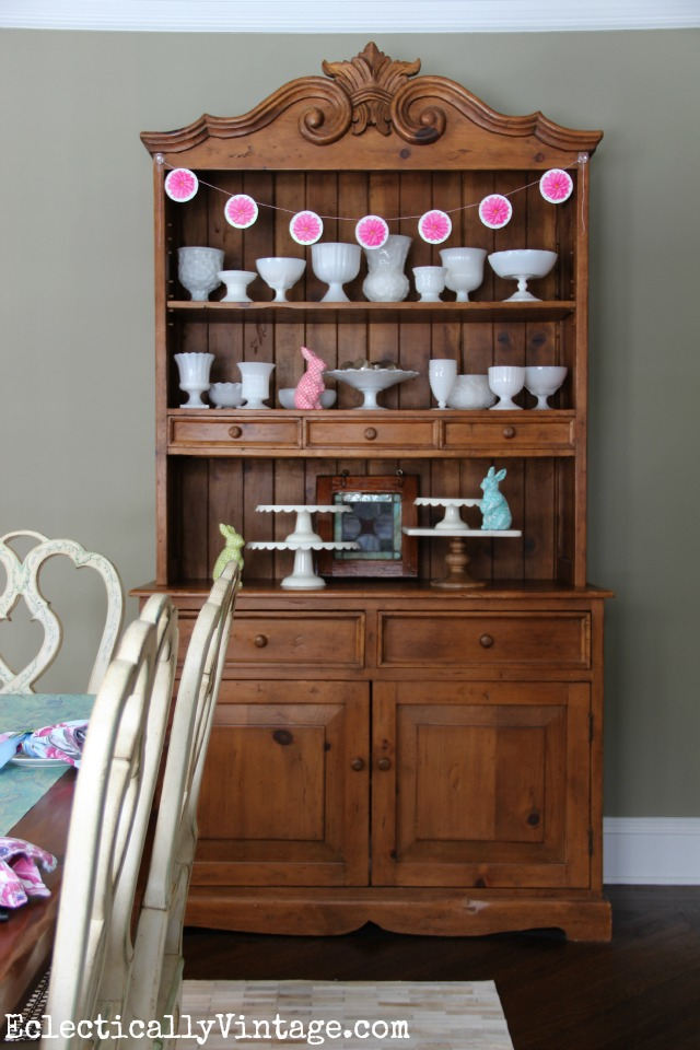 Love this dining room hutch decked out for spring - the milk glass collection is beautiful kellyelko.com
