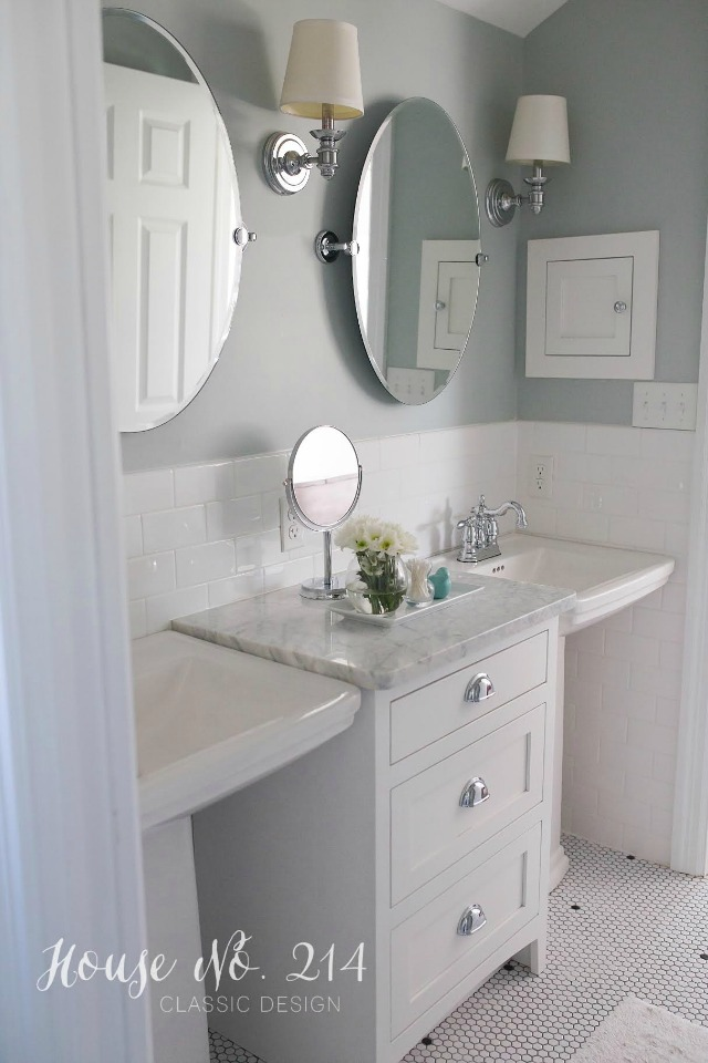 Love the double sinks with the carrara topped cabinet in between kellyelko.com