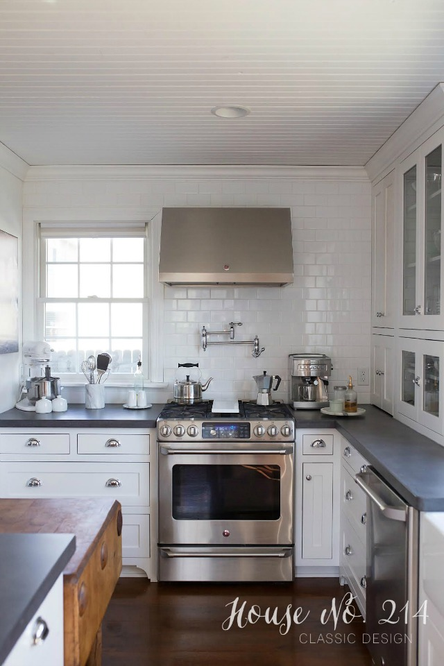 Love the white subway tile going to the ceiling and the bead board ceiling - beautiful white kitchen kellyelko.com