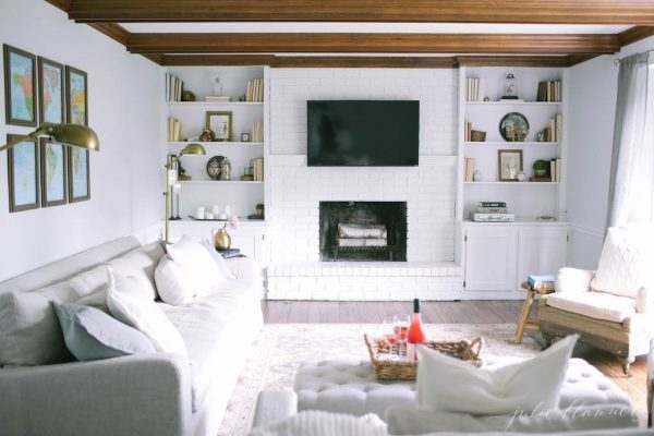 Cozy family room with rustic ceiling beams - love the built ins kellyelko.com