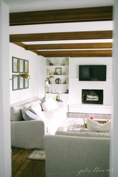 Love the rustic ceiling beams in this family room kellyelko.com