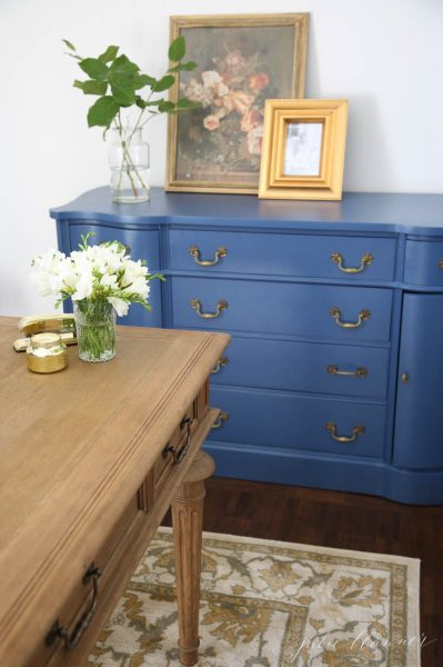 Love the peacock blue dresser in this home office kellyelko.com