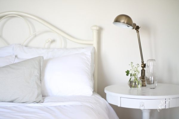 Love the brass pharmacy lamp in this guest bedroom kellyelko.com