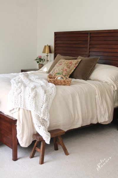 Dreamy master bedroom - love the texture from the chunky throw kellyelko.com