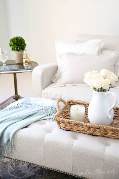Love this neutral living room and the texture from the throw and basket kellyelko.com