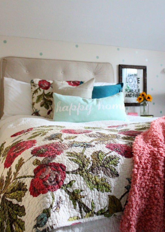 Love this cheery bedroom - the floral quilt and the polka dot walls kellyelko.com